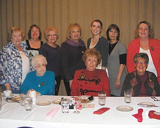 Youngstown Charter Chapter of ABWA  presented a scholarship at its Feb. 15 meeting. In the back row, from left, are Treasurer Mary Ann Rushton; President Cathy Pokrivnak; Secretary Sue Morell; Patti Mika; scholarship winner Katelyn Gould; her mother, Mary Gould; and Patti Coogan. In the front row, from left, are June Balint, Jean Backman and Mary Lou Lewis. Members not pictured are Vice President Beth Stanko and Peg Broadwater.