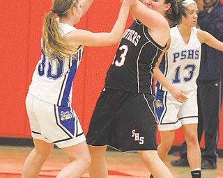 Stuthers' Hannah Dubec (13) is trapped by Maura Bobby (30) during their game Thursday night in Austintown.