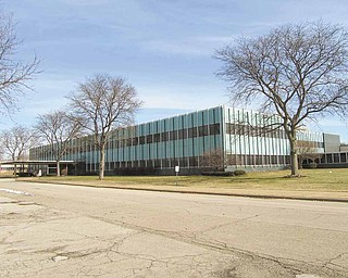 The former engineering building, above, at Delphi Packard Electric will be demolished along with a manufacturing building at the company's North River Road facilities in Howland.
