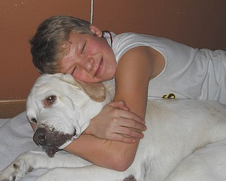 Sierra Banks, 13, of Columbus, Ohio, shows nothing but love for Koda, his Labrador. Photo taken and submitted by Sierra's grandma, Lenore Banks of Boardman.