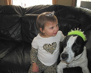 Isabella LaMont, 2, daughter of Ronda and Keith LaMont of Lowellville, plays princess dress-up with her dog Gotti. Photo submitted by Cindy Perry of Lowellville.