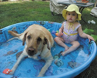"Michalea and Bella Roberts of Bowie, Md., enjoy some summer weather while relaxing in the pool. They are the granddaughter and ""granddog"" of Thomas and Joanne Roberts of Canfield."