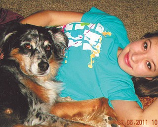 Alexa Marco, 13, relaxes on the floor with her Australian Shepherd, Angus. They live in Boardman. Photo taken and submitted by Alexa's mom, Paula.
