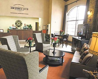 The lobby of the Eagles Nest Lodge at the Youngstown Air Reserve Station in Vienna features comfortable furniture and a large flat-screen television in front of the check-in desk. However, federal budget cuts could bring construction of additional new lodging at the air base to a halt.