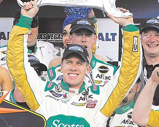Carl Edwards celebrates his victory in the NASCAR Sprint Cup Series auto race Sunday, March 6, 2011, in Las Vegas.