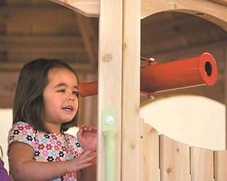 Giuliana Ricchiuti, 4, gets an eyeful at Skedaddles Indoor Playground on Market Street. Giuliana inspired her mom, Dini Ricchiuti, to open Skedaddles.