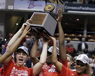 Ohio State's Sarah Schulze, left, Jantel Lavender, and Brittany Johnson, right, hold the championship trophy after Ohio State defeated Penn State 84-70 in an NCAA college basketball game, winning the Big Ten tournament in Indianapolis, Sunday, March 6, 2011. (AP Photo/Michael Conroy)