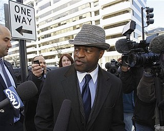 NFLPA Executive Director DeMaurice Smith, center, accompanied by NFLPA spokesman with George Atallah, left, leave after football labor negotiations in Washington Friday, March 4, 2011. (AP Photo/Alex Brandon)