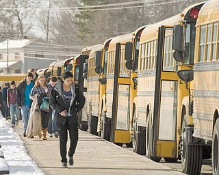 Students at Poland Seminary High School board their school buses after their 3:03 p.m. dismissal from classes.