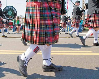 The Red Hackle Pipe and Drum Corp, from Cleveland, Ohio, marches along Market Street during the 2009 Mahoning Valley St. Patrick's Day Parade.