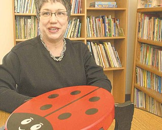 Carole Bopp, Hope House Visitation Center executive director, sits at a lady bug table. Lady bugs are the theme in one of the Center's visitation rooms and are scattered throughout the facility, which in Fiscal Year 2010 provided services for 136 children, 155 adults and 177 families.