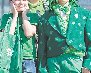 "Jeremy Brown, 12, mother Maryann Brown, both of Homeworth, and friend, Parker Zamarelli, of Salem stand along Market Street during the 2009 Mahoning Valley St. Patrick's Day Parade. ""Its really cool,"" said Zamarelli who  said he hadn't been the the parade since he was much younger as he dawned an frog costume recently worn in a school production."