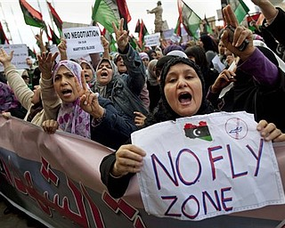Libyan women protest to demand the resignation of Libyan leader Moammar Gadhafi and for a no-fly zone during a demonstration in Benghazi, eastern Libya, Wednesday, March 9, 2011.
