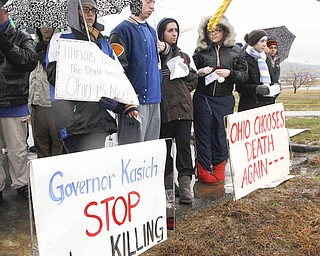 A group  of death penalty opponents stand outside the Southern Ohio Correctional Facility before the execution of Johnnie Baston, Thursday, March 10, 2011 in Lucasville, Ohio. Baston was the first person to be executed in the United States with a single dose of pentobarbital.