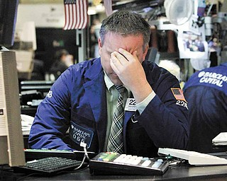 Specialist Christopher Culhane works at his post on the floor of the New York Stock Exchange Thursday, March 10, 2011.