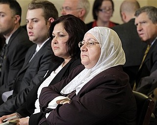 Samira Hussein, center, of Montgomery County , Md., and other audience members listen to testimony at a hearing of the House Homeland Security Committee, on 'the extent of the radicalization' of American Muslims, on Capitol Hill in Washington, Thursday, March 10, 2011.