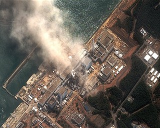 This satellite image provided by DigitalGlobe shows the damaged Fukushima Dai-ichi nuclear facility in Japan on Monday, March 14, 2011. Authorities are strugging to prevent the catastrophic release of radiation in the area devastated by a tsunami.