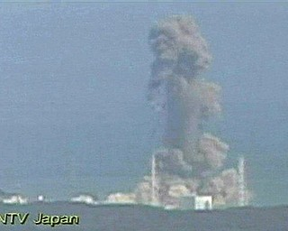 In this image made off Japan's NTV/NNN Japan television footage, smoke ascends from the Fukushima Dai-ichi nuclear plant's Unit 3 in Okumamachi, Fukushima Prefecture, northern Japan, Monday, March 14, 2011. The second hydrogen explosion in three days rocked Japan's stricken nuclear plant Monday, sending a massive column of smoke into the air and wounding 11 workers.