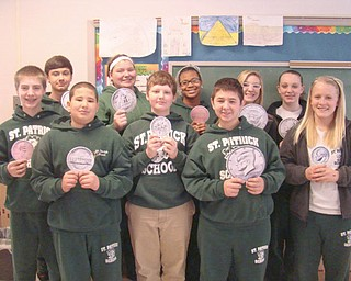"Students in the eighth-grade class at St. Patrick School in Hubbard were the winners of a ""Pennies for Pasta"" campaign recently at the school. The class raised $412.68 to be donated to the National Leukemia Foundation. A total of $686.78 was raised for the foundation at the school during the fundraiser. Displaying symbolic pennies are the campaign winners, from left, in front, Justin Oaks, Josh Fernandez, Josh DiTimosso, Matt Baytosh and Katie Conlan, and in back, Bobby Dulay, Lexi Pennick, Miriam Denis, Emily Manion and Gabby Hosack."