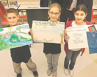 From left, Keith Burnside, Ciara Davis and Maci Musolino show off their winning entries in the stormwater poster contest the city of Struthers sponsored for fourth-graders at Struthers Elementary School. The winners were announced at an assembly Wednesday.