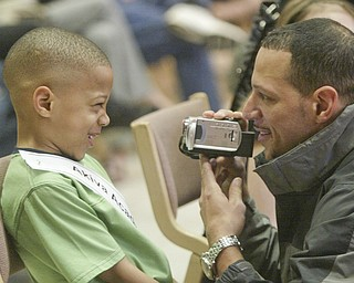 William D. Lewis The Vindicator Bronx Teague, Akiva Academy speller gets videoed by his father Brian Teague before competing in Vindicator Spelling bee Saturay.