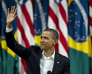 President Barack Obama waves before delivering a speech at the Municipal Theater in Rio de Janeiro, Brazil, Sunday, March 20, 2011. Obama arrived in Brazil on Saturday for the start of a three-country, five-day tour of Latin America.