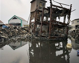 A building damaged by the March 11 earthquake and tsunami stands still in Kesennuma, Miyagi Prefecture, Japan, Sunday, March 20, 2011.