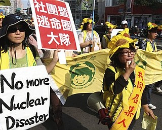 More than 3,000 Taiwanese people demonstrate against the ongoing construction of the fourth nuclear power plant on the island, Sunday, March 20, 2011, in Taipei, Taiwan. The rally came as Taiwanese were alarmed by neighbor Japan's scramble for control over an ongoing nuclear reactor crisis triggered by a 9.0-magnitude earthquake more than a week ago. Despite the crisis, Taiwanese President Ma Ying-jeou has said the construction of the new nuclear power plant will continue. Taiwan is prone to earthquakes like Japan, and a 7.6-magnitude earthquake in central part of the island in 1999 killed more than 2,300 people.