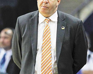 Tennessee head coach Bruce Pearl walks the sideline in the closing seconds of the second half of a West Regional NCAA tournament second round college basketball game against Michigan, Friday, March 18, 2011, in Charlotte, N.C. Michigan won 75-45.