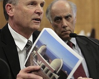 Steve David, director of site services at the Diablo Canyon Power Plant, displays a picture of the nuclear power plant, located near San Luis Obisop, as he discusses the plant's safety in case of an earthquake, during a hearing at the Sacramento,  Calif., Monday March 21, 2011.  A Senate select committee took testimony from various state agencies, natural gas utilities and the operators of California's nuclear power plants on the state's ability to handle an earthquake and possible tsunami like the one the struck Japan last week.   At right is Daniel Hirsch, lecturer in nuclear policy at the University of California, Santa Cruz.