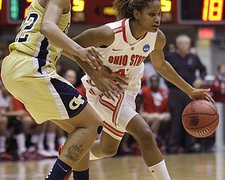 Ohio State's Brittany Johnson, right, drives to the basket against Georgia Tech's Alex Montgomery during the first half of a second-round NCAA women's college basketball tournament game Monday, March 21, 2011, in Columbus, Ohio.