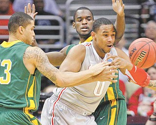 Ohio State's Jared Sullinger (0) loses the ball against George Mason's Isaiah Tate (13) and Mike Morrison, back, in the first half of an East regional NCAA college basketball tournament third-round game Sunday, March 20, 2011, in Cleveland.