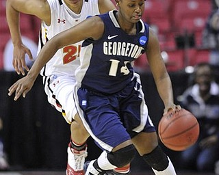 Georgetown's Sugar Rodgers steals the ball from Maryland's Alyssa Thomas during the first half of a second-round game in the NCAA women's college basketball tournament Tuesday, March 22, 2011, in College Park, Md.