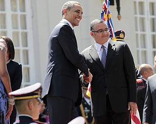 President Barack Obama shakes hands with El Salvador President Mauricio Funes during an arrival ceremony at the National Palace in San Salvador, El Salvador, Tuesday, March 22, 2011.