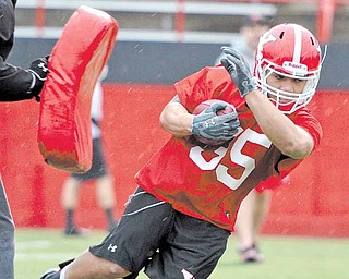 Youngstown State's Jamaine Cook runs drills during the Penguins' first spring practice Wednesday at YSU's 