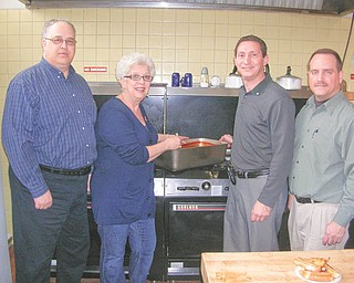 Here's what's cookin': Involved in preparations for an annual spaghetti dinner to be sponsored by Struthers Rotary Club are, from left, Tom Baringer, dinner chairman; Mary Ann Morell, head chef; Don Gabriele, dinner co-chairman; and Bryan Higgins, club president. Assisting them at the event from 3 to 7 p.m. April 2 at St. Nicholas Social Hall, 765 Fifth St., Struthers, will be members of Struthers High School Interact Club and of Boy Scout Troop 101. Meals will be $6 for adults and $3 for children under 12 and proceeds will benefit local community projects.