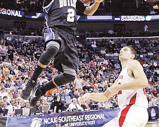 Butler's Shawn Vanzant (2) shoots in front of Wisconsin's Keaton Nankivil during the first half of the NCAA Southeast regional college basketball semifinal game Thursday, March 24, 2011, in New Orleans. (AP Photo/David J. Phillip)