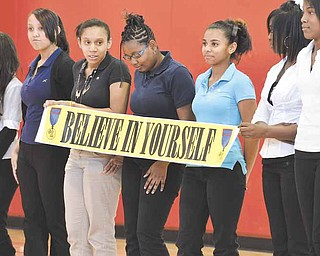 "Members of an eighth-grade social studies class at Wilson Middle School help display a banner during a play called ""K.C.'s Dream."" The play was part of the Black History Project presented Thursday at the Youngstown school on the city's South Side."