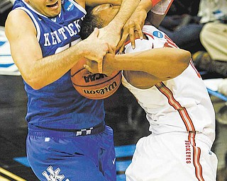 Kentucky's Josh Harrellson, left, fights for control of the ball with Ohio State's Jared Sullinger, right, during the first half of an an East regional semifinal game in the NCAA college basketball tournament Friday, March 25, 2011, in Newark, N.J.