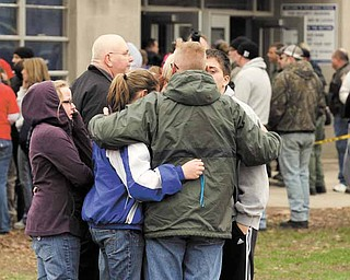 Parents and students gather after students were released following an early morning shooting at West Middle School in Martinsville, Ind., Friday, March 25, 2011. A gunman opened fire at the middle school before classes began Friday, shooting a student in the stomach, police said. A 15-year-old classmate who had been suspended was taken into custody.