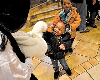 Daelyn McGuiere,3, of Youngstown visits with Mother Goose played by story teller Barbra Root at the Plant the Seed to Read book festival.