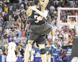 Butler's Ronald Nored (5) jumps into the arms of teammate Matt Howard after overtime of the NCAA Southeast regional college basketball championship game Saturday, March 26, 2011, in New Orleans. Butler won 74-71 to advance to the Final Four.