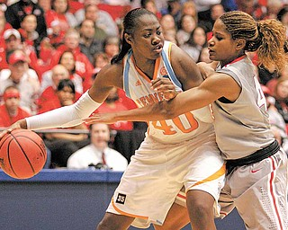 Tennessee guard/forward Shekinna Stricklen (40) is guarded by Ohio State center Jantel Lavender during the second half of an NCAA women's college basketball tournament regional semifinal, Saturday, March 26, 2011 in Dayton, Ohio. Stricklen led Tennessee to an 85-75 win with 20 points.