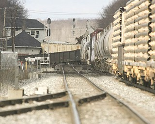 Looking westbound, a few train cars set sideways on the tracks Monday morning after a CSX train derailed near North Center Street in Newton Falls.