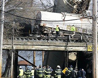 Firefighters and HAZMAT crews from Mahoning Trumbull and Portage county assess the damage Monday after a CSX train carrying ammonia and chlorine derailed near North Center Street in Newton Falls.