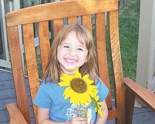 Riley Sweder of Columbus proudly shows off her own garden-grown sunflowers. Picture taken and sent in by her mom, Carolyn Sweder, a former New Middletown resident.