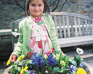 Morgan Rolley of Austintown enjoys some lovely flowers at Fellows Riverside Gardens. She visited in 2010 at Easter. Photo sent in by Barb Rolley.