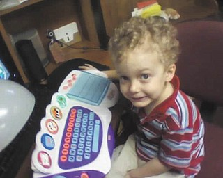 Timmy Kerr, 4, of Poland, plays with his computer while waiting for warmer weather. Photo sent in by Gary Kerr.