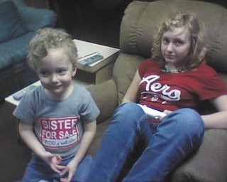 Timmy Kerr, 4, and Kayla Kerr, 14, play the Wii while waiting for warmer weather. They're both from Poland. Photo submitted by Gary Kerr.