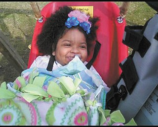 Dereon North of Campbell enjoys her new Jennswing for kids with disabilities.